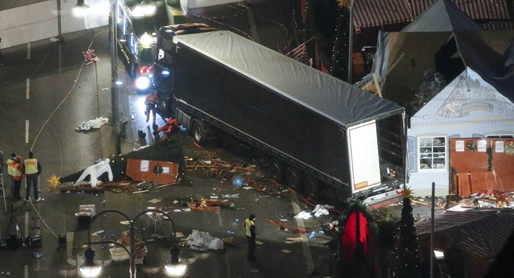 A used suit of a forensic investigator lies on a Christmas tree where a truck ploughed through a crowded Christmas market killing 12 people in the west of Berlin, Germany, December 20, 2016