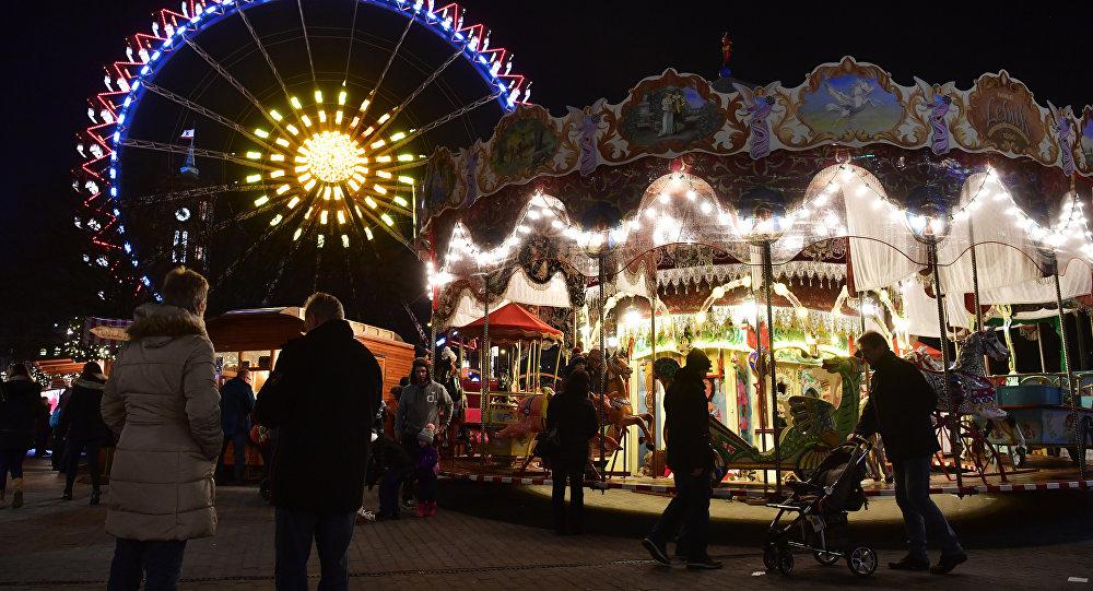 People visit the Christmas market at Berlin's Alexanderplatz with its big wheel, two days after an attack at the Christmas market near the Kaiser-Wilhelm-Gedaechtniskirche (Kaiser Wilhelm Memorial Church), in central Berlin, on December 21, 2016