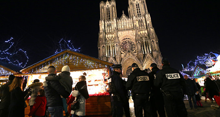 French police officers patrol at the Christmas market next to the Cathedral of Notre-Dame de Reims. File photo