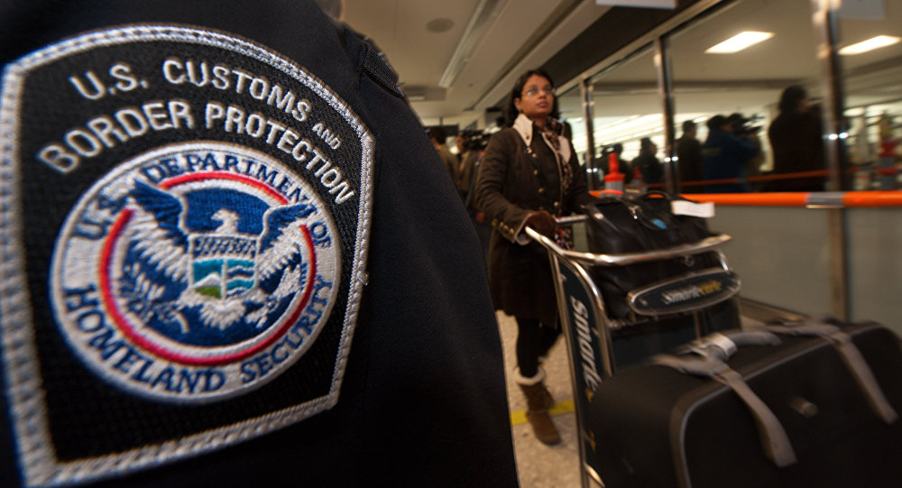 An international air traveler clears US Customs and Border Protection declarations to enter the United States