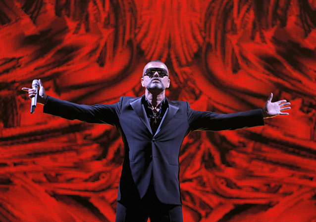 FILE - In this Sept. 9, 2012 file photo, British singer George Michael performs at a concert to raise money for AIDS charity Sidaction, during the Symphonica tour at Palais Garnier Opera house in Paris, France.