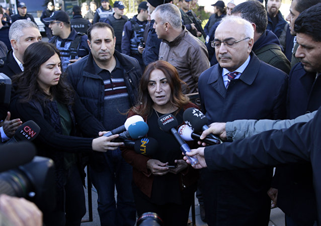 Aysel Tugluk, a pro-Kurdish politician, speaks to the media during a protest against the detention of pro-Kurdish Peoples' Democratic Party, or HDP, lawmakers, in Ankara, Turkey, Friday, Nov. 4, 2016