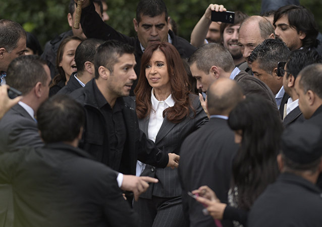 Former Argentine President Cristina Fernandez de Kirchner (C) gestures as she leaves the Federal Court in Buenos Aires on April 13, 2016. Fernandez de Kirchner testified in an investigation into whether she mishandled public funds in connection with Central Bank currency-related operations during the final months of her presidency.