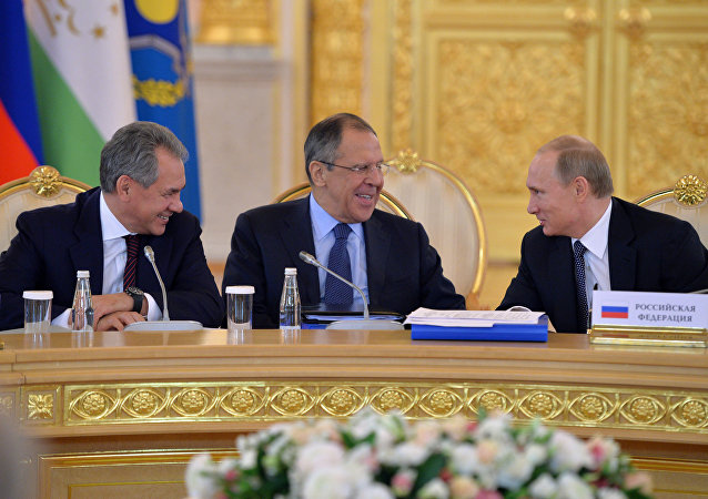 From right: Russia's President Vladimir Putin, Foreign Minister Sergei Lavrov and defense Minister Sergei Shoigu. File photo