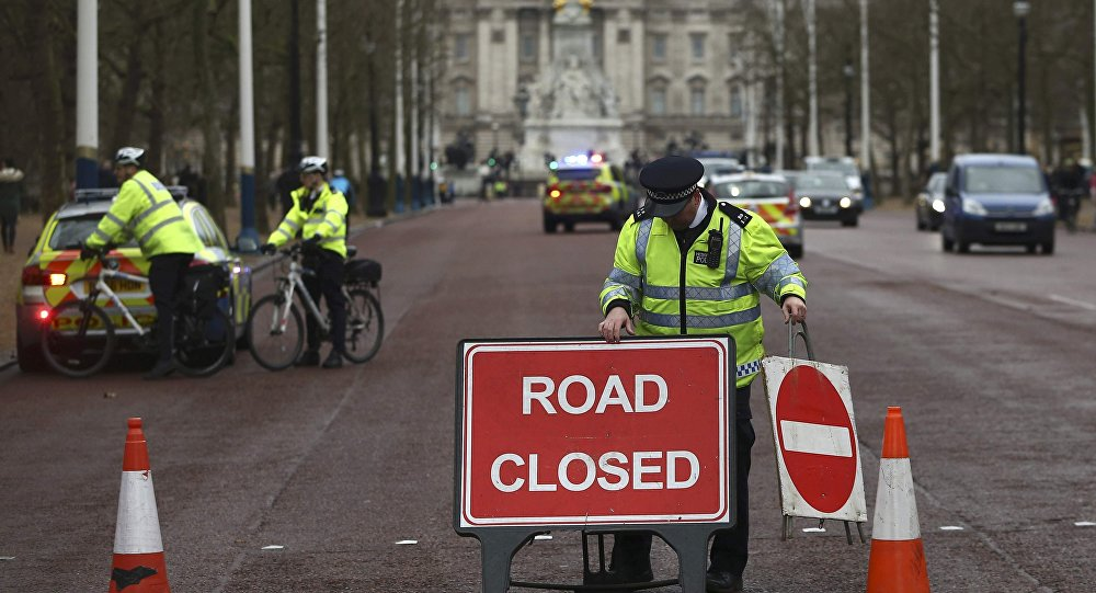 Police close a road during near Buckingham Palace in London
