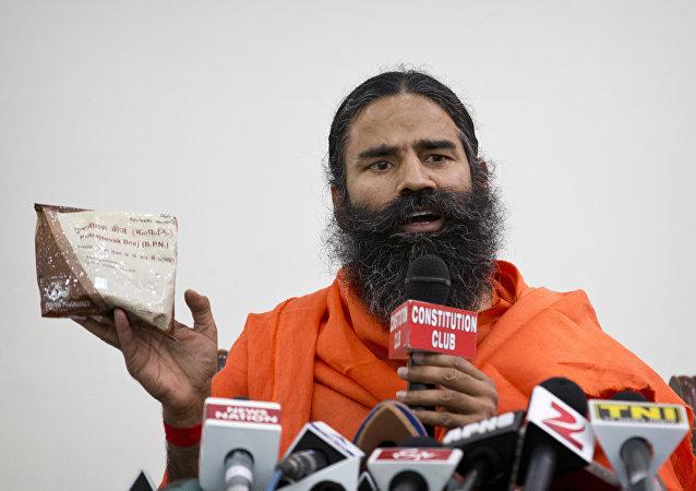 "Indian yoga guru Baba Ramdev displays a packet of Ayurvedic medicine called ""Putrajeevak Beej"", which is produced by Patanjali Ayurveda Kendra, part of a trust established by him in New Delhi, India (File)"