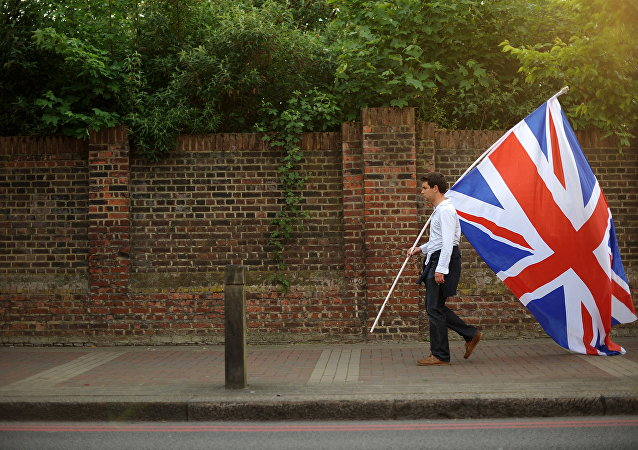 Young man in London carrying the Union Jack