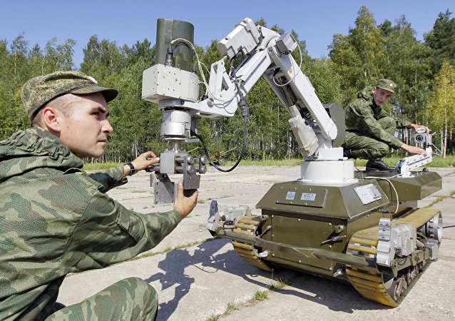 Servicemen from the fresh replacement of the NBC Defense Forces' 200th rapidly-deployment unit, seen using unmanned ground systems for radiological terrain reconnaissance during their field exercises in the Bolshoye Bunkovo Village