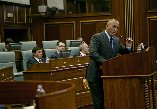 Member of the opposition Ramush Haradinaj addresses Kosovo lawmakers during a debate passing constitutional amendments that would allow the establishment of a special court to prosecute its top leaders and former guerrilla fighters for war crimes in capital Pristina on Monday, Aug. 3, 2015.