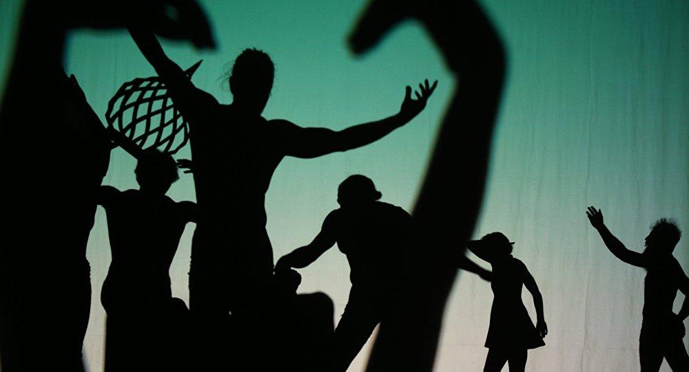 Perfomance of the American shadow circus Pilobolus