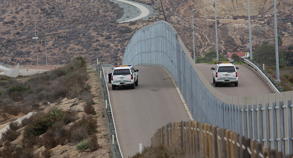 Border Patrol agents patrol the United States-Mexico Border wall during Opening the Door Of Hope/Abriendo La Puerta De La Esparana at Friendship Park in San Ysidro, California, November 19, 2016