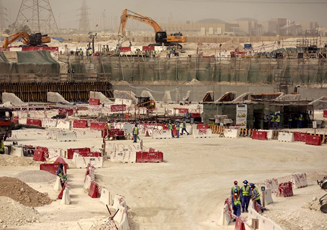 Laborers work at the Al-Wakra Stadium that is under construction for the 2022 World Cup, in Doha, Qatar (File)