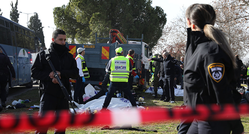 Israeli Zaka volunteers examine a body of one of the four Israeli soldiers killed when a Palestinian truck driver ran into the group at the Jerusalem promenade