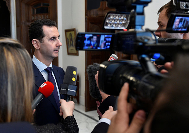 Syria's President Bashar al-Assad speaks to French journalists in Damascus, Syria, in this handout picture provided by SANA on January 9, 2017