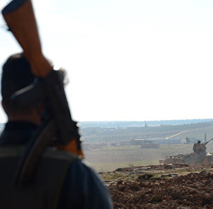Fighters from the Free Syrian Army monitor the area during battles against Islamic State (IS) group jihadists near the town of Qabasin, located northeast of the city of Al-Bab