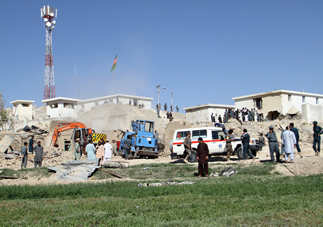 Afghan security forces work at the site of a bombing in Kandahar (File)