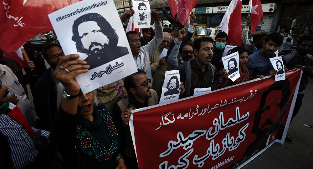 Supporters of Awami Worker Party hold a demonstration to condemn the missing human rights activists, in Karachi, Pakistan, Tuesday, Jan. 10, 2017