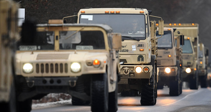 US military vehicles make their way on an army training camp near Brueck, northeastern Germany, on January 11, 2017