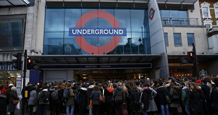 Commuters queue outside Brixton tube station in London, Britain January 10, 2017