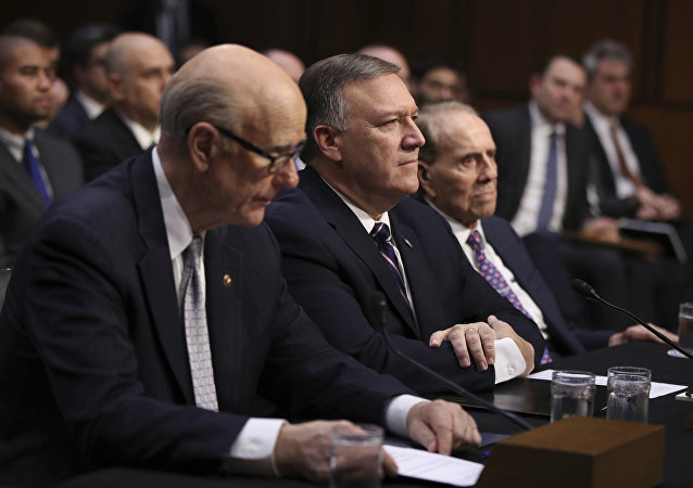 CIA Director-designate Rep. Michael Pompeo, R-Kan., center, flanked by former Senate Majority Leader Bob Dole, right, and Sen. Pat Roberts, R-Kan., listens on Capitol Hill in Washington, Thursday, Jan. 12, 2017, at his confirmation hearing before the Senate Intelligence Committee