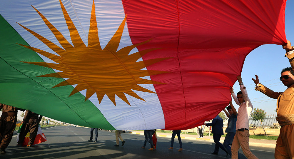 Iraqi Kurdish demonstrators wave a large Kurdish flag (File)