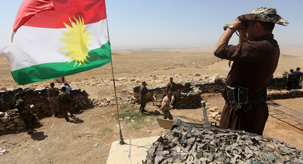 A flag of the autonomous Kurdistan region flies as Iraqi Kurdish Peshmerga fighters take position to monitor the area from their front line post in Bashiqa, a town 13 kilometres north-east of Mosul (File)