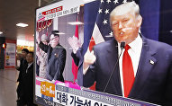 A TV screen shows pictures of U.S. President-elect Donald Trump, right, and North Korean leader Kim Jong Un, at the Seoul Railway Station in Seoul, South Korea, Thursday, Nov. 10, 2016