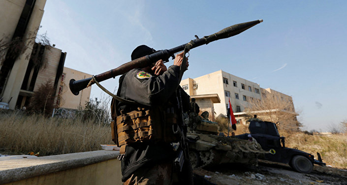 A member of Iraqi Special Operations Forces (ISOF) carries a rocket launcher at the University of Mosul during a battle with Daesh militants, in Mosul, Iraq, January 14, 2017