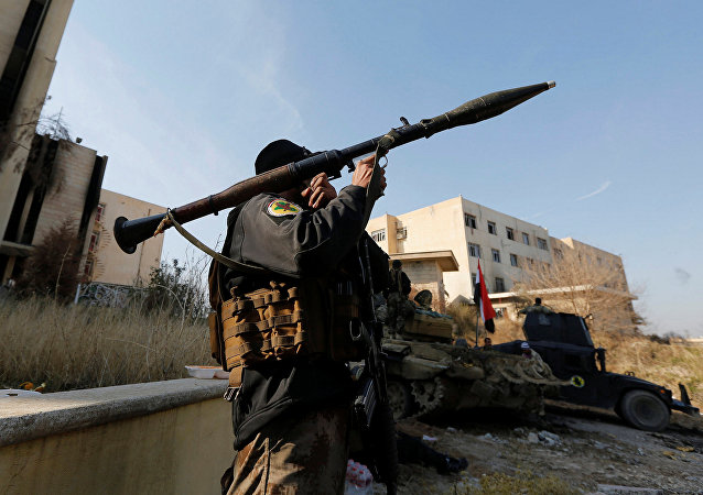A member of Iraqi Special Operations Forces (ISOF) carries a rocket launcher at the University of Mosul during a battle with Islamic State militants, in Mosul, Iraq, January 14, 2017