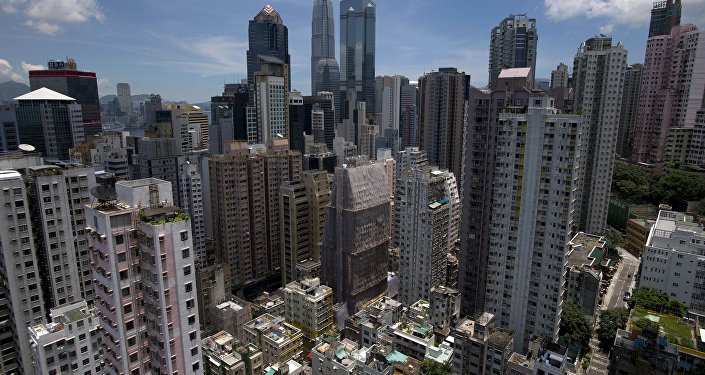 The Sheung Wan neighbourhood (bottom) on Hong Kong island is seen from a residential building with the skyscrapers of the central business district behind. (File)