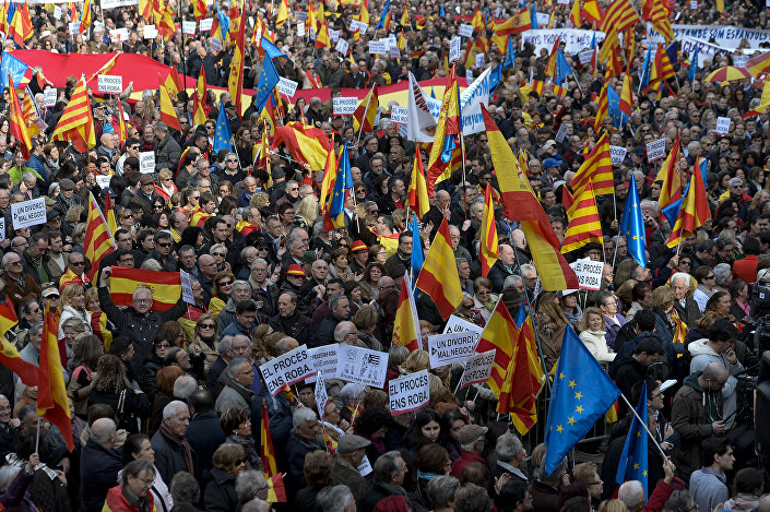 Demonstrators wave European, Spanish and Catalan flags during a demonstration called by Sociedat Civil Catalana (Catalan Civil Society) to support the unity of Spain, at Catalonia square in Barcelona