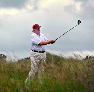 Donald Trump plays a stroke as he officially opens his new multi-million pound Trump International Golf Links course in Aberdeenshire, Scotland, on July 10, 2012