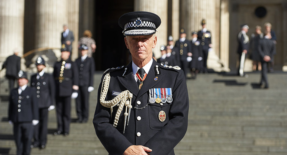 Chief of the Metropolitan police Bernard Hogan-Howe poses for a photograph on the steps of St Paul's Cathedral ahead of the National Police Memorial Day Service at St Paul's Cathedral in London on September 25, 2016