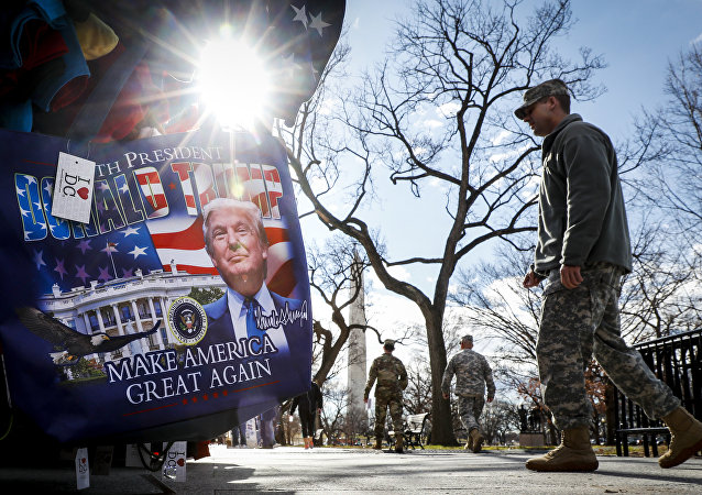 Military personnel walk along the National Mall in Washington, Wednesday, Jan. 18, 2017, alongside vendors selling President-elect Donald Trump merchandise ahead of Friday's presidential inauguration