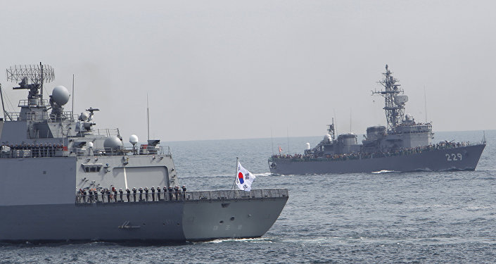 "South Korea's Dea Joyeong vessel travels alongside the Japanese escort ship ""Abukuma"" during an event held ahead of Sunday's official triennial Maritime Self-Defense Force fleet review off Sagami Bay, south of Tokyo, Japan, Thursday, Oct. 15, 2015"