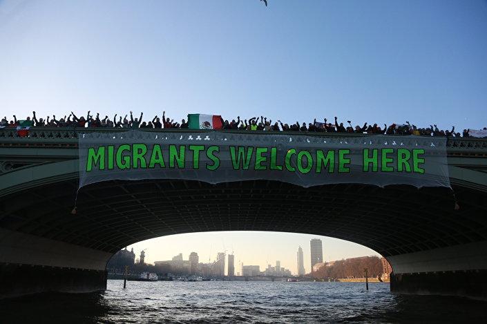'Migrants Welcome Here' banner hanging over Westminster Bridge, London