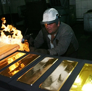 Standard 24 karat gold bars being cast in the foundry of the Novosibirsk gold refinery