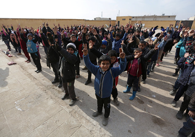 Students gesture as they stand in line in Syria January 16, 2017