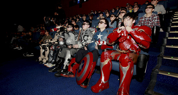 A group of fans dressed in homemade replica armour of Avengers: Age of Ultron movie characters, Iron Man, Captain America and Thor, watch the film in a theatre in Changchun, Jilin province, China on May 16, 2015