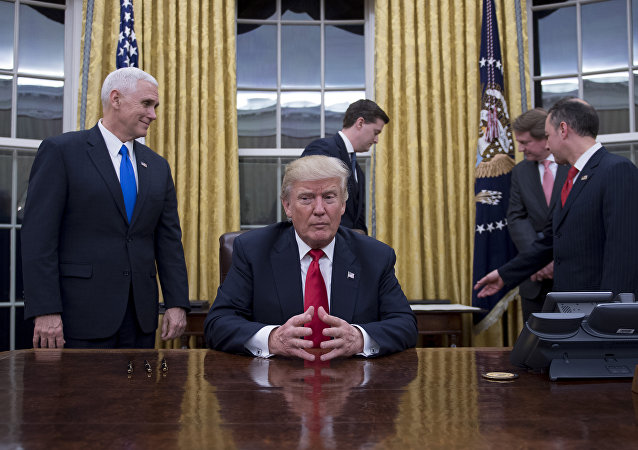 US President Donald Trump (C) waits at his desk before signing confirmations for James Mattis as US Secretary of Defense and John Kelly as US Secretary of Homeland Security, as Vice President Mike Pence (L) and White House Chief of Staff Reince Priebus (R) look on, in the Oval Office of the White House in Washington, DC, January 20, 2017