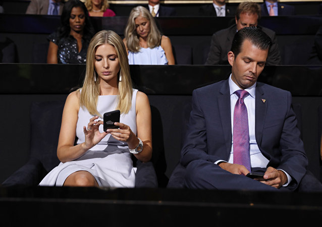 Republican Presidential Candidate Donald Trump's children Ivanka Trump and Donald Trump Jr., check on their phones during the second day session of the Republican National Convention in Cleveland, Tuesday, July 19, 2016.