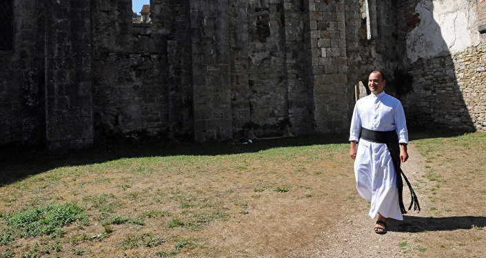 Father Guillaume Soury-Lavergne walks in the Benedictine abbey of Marcilhac-sur-Cele, in the Lot gorges, southern France. (File)