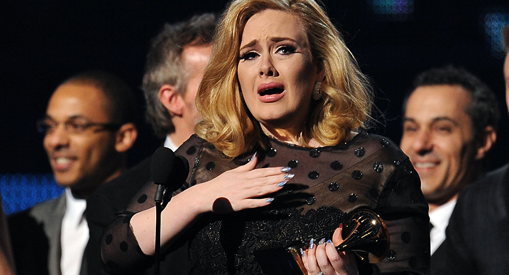 Singer Adele cries as she accepts her Grammy for Album of the Year at the Staples Center during the 54th Grammy Awards in Los Angeles, California, February 12, 2012.