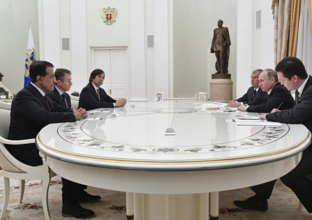 Russian President Vladimir Putin (2nd R), accompanied by Igor Sechin (3rd R), the CEO of oil giant Rosneft, meets with participants of Rosneft privatisation deal: Bank Intesa CEO Carlo Messina (3rd L), Glencore CEO Ivan Glasenberg (2ndL) and Sheikh Abdulla bin Mohammed bin Saud Al-Thani, chief executive of the Qatar Investment Authority (QIA), at the Kremlin in Moscow