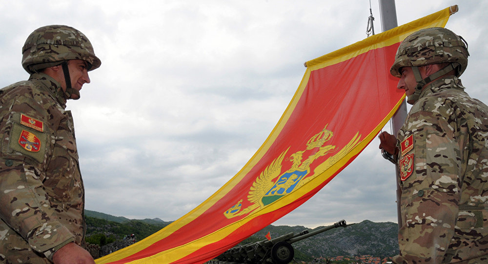 Montenegrin Army soldiers fire artillery look at the Montenegro flag during preparations on the eve of Independence day, on May 20, 2010 in Cetinje