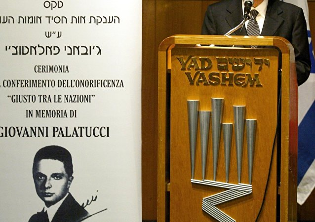 Italian Interior Minister Giuseppe Pisanu speaks during a ceremony honoring Giovanni Palatucci as a Righteous Among the Nations at the Yard Vashem holocaust museum in Jerusalem, 10 February 2005.