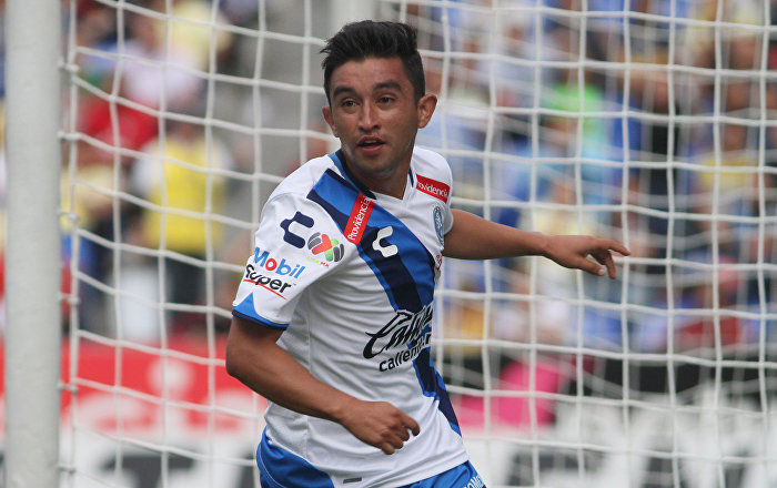Christian Bermudez of Puebla celebrates his goal against America during their Mexican Apertura 2016 Tournament football match at the Cuauhtemoc stadium on August 21, 2016, in Puebla, Mexico