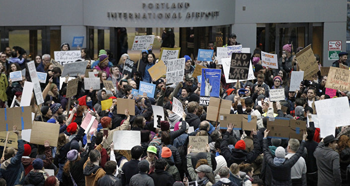 Activists gather at Portland International Airport to protest against President Donald Trump's executive action travel ban in Portland, Oregon, U.S. January 29, 2017