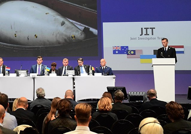 Members of a joint investigation team present the preliminary results of the criminal investigation into the downing of Malaysia Airlines flight MH17 , in Nieuwegein, on September 28, 2016