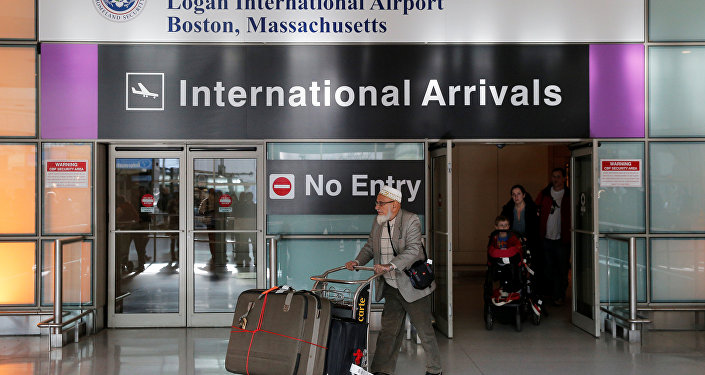 International travelers arrive after U.S. President Donald Trump's executive order travel ban at Logan Airport in Boston, Massachusetts, U.S